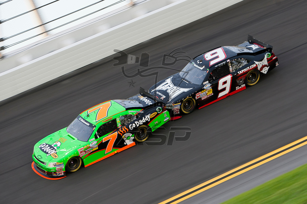 Daytona Beach, FL - July 01, 2011:  Danica Patrick and Tony Stewart race off turn four during the Subway Jalapeno 250 at Daytona International Speedway in Daytona Beach, FL.