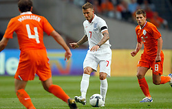 David Beckham (ENG) takes on  Styn Schaars and Joris Mathijsen (NED) during the International Friendly between Netherlands and England at the Amsterdam Arena on August 12, 2009 in Amsterdam, Netherlands.