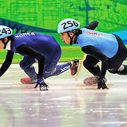 February 13, 2009 - 2010 Winter Olympics - Vancouver, Canada - Lee Jung-Su slips while leading Apolo Anton Ohno during 1500m Short Track Speed Skating competition held at the Pacific Coliseum during the 2010 Winter Olympic Games.