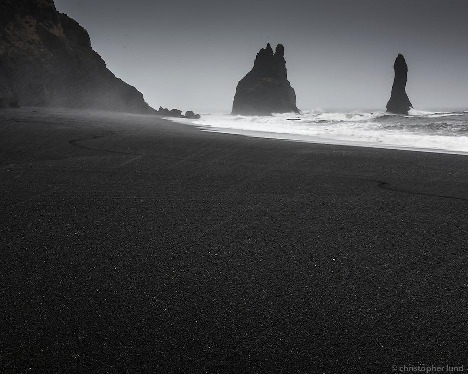Reynisfjara black sand beach with Reynisdrangar sea stacks in background. South Iceland.