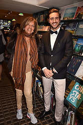 Dr Filip Koidis and Vimla Lalvani at a party to celebrate the publication of Saving The World by Paola Diana at Daunt Books, Marylebone, London England. 2 May 2018.