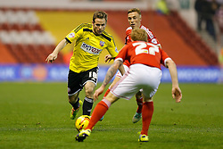 Alan Judge of Brentford is challenged by Chris Burke of Nottingham Forest - Photo mandatory by-line: Rogan Thomson/JMP - 07966 386802 - 05/11/2014 - SPORT - FOOTBALL - Nottingham, England - City Ground - Nottingham Forest v Brentford - Sky Bet Championship.