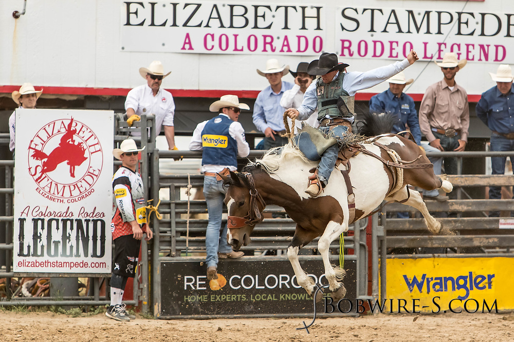 Saddle brond rider Shade Etbauer rides Summit Pro Rodeo's Fringe Benefit during the third performance of the Elizabeth Stampede on Sunday, June 3, 2018.