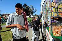 KIds buy ice-cream from a vendor at La Paz Park, part of the Community Alliance for Safety and Peace coverage area. CASP is an ambitious program that aims to steer youth away from gang violence and toward solutions offered by more than 30 local organizations offering alternatives.