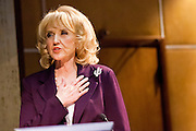 14 FEBRUARY 2012 - PHOENIX, AZ:    Arizona Governor JAN BREWER recites the Pledge of Allegiance in the Arizona State Senate before violinist Itzhak Perlman performed the Star Spangled Banner in the senate with the Southwest Stringers, a violin orchestra of elementary school students from Mesa, AZ.      PHOTO BY JACK KURTZ