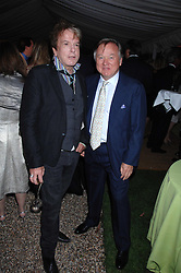 Left to right, NICKY HASLAM and SIR ANTHONY BAMFORD at the annual Cartier Chelsea Flower Show dinner held at the Chelsea Physic Garden, London on 21st May 2007.<br /><br />NON EXCLUSIVE - WORLD RIGHTS