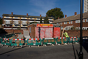 Pavement work and old corner shop in Stratford housing estate, adjacent to the 2012 Olympic site im east London.