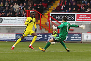 Mohamed Eisa goes around Glenn Morris to score his 2nd goal of the game during the EFL Sky Bet League 2 match between Crawley Town and Cheltenham Town at the Checkatrade.com Stadium, Crawley, England on 24 March 2018. Picture by Antony Thompson.