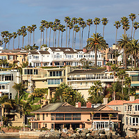Photo of Newport Beach luxury homes in the Corona del Mar neighborhood.  Newport Beach is a wealthy beach community along the Pacific Ocean in Southern California. Photo is high resolution and was taken in 2012.