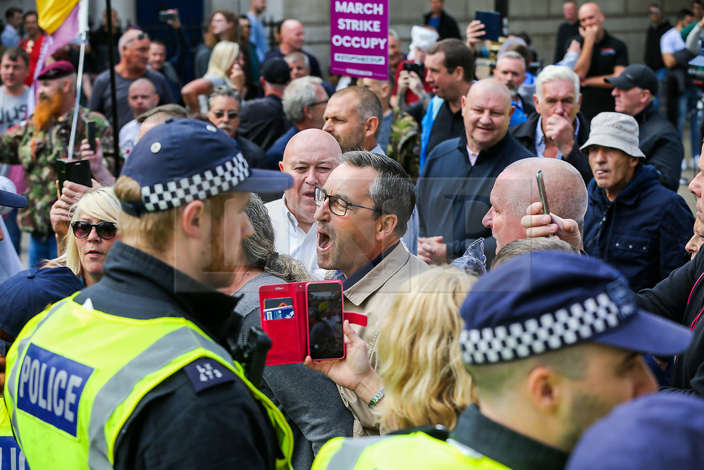 "© Licensed to London News Pictures. 07/09/2019. London, UK. Pro Brexit protesters confront police officers in Whitehall as anti-Brexit protesters take part in ""Defend our Democracy and Stop Brexit"" demonstration in Whitehall, Westminster. The protesters are demonstrating against the British Prime Minister Boris Johnson's intention to prorogue Parliament until 14 October. Photo credit: Dinendra Haria/LNP"