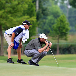 2009 April 26: Steve Marino of Tequesta, FL lines up a putt on the 14th hole during the final round of the Zurich Classic of New Orleans PGA Tour golf tournament played at TPC Louisiana in Avondale, Louisiana.