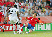 Photo: Chris Ratcliffe.<br /> Czech Republic v Ghana. Group E, FIFA World Cup 2006. 17/06/2006.<br /> Michael Essien of Ghana clashes with Karel Poborsky of the Czech Republic.