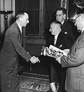 European Recovery Act, known as The Marshall Plan, the United States' programme for the rebuilding of Europe after World War II and to stop the spread of Communism. Beginning in 1947, the plan lasted for four years. Greek railway workers presenting the American Ambassador, Milton Katz, with a branch of an olive tree.