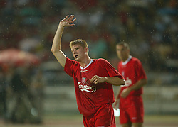 BANGKOK, THAILAND - Thailand. Thursday, July 24, 2003: Liverpool's Neil Mellor celebrates his disallowed goal against Thailand during a preseason friendly match at the Rajamangala National Stadium. (Pic by David Rawcliffe/Propaganda)