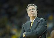 December 04 2010: Iowa Hawkeyes head coach Fran McCaffery looks up at the scoreboard during the second half of their NCAA basketball game at Carver-Hawkeye Arena in Iowa City, Iowa on December 4, 2010. Iowa won 70-53.