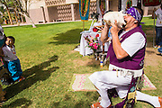 25 APRIL 2012 - PHOENIX, AZ: MANUEL LARES, an opponent of SB1070, blows a conch to call people to prayer in front of the Arizona state capitol Wednesday. Immigrants' rights groups opposed to SB1070 and Tea Party affiliated groups that support SB1070 gathered at the state capitol in Phoenix Wednesday to express their opposition and support of the bill. SB1070 was signed by Arizona Governor Jan Brewer in April 2010. At the time it was the toughest anti-illegal immigration bill in the country. Immigrants' rights groups sued Arizona and the federal courts stopped enforcement of the bill. The bill ended up in the US Supreme Court which heard arguments Wednesday. A ruling on the bill is expected in June.   PHOTO BY JACK KURTZ