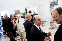 """Palermo, Italy - 20 July, 2012: Representatives of the Carabinieri and of the Guardia di Finanza, two of Italy's armed forces, chat before a civil gold medal delivery ceremony at Palazzo d'Orléans, the headquarters of the presidency of the Sicilian region in Palermo on 20 July, 2012. <br /> <br /> Mario Monti has expressed """"serious concerns"""" that Sicily's regional government is heading towards default and has asked its governor – who is under investigation for suspected links to the Mafia – to confirm his intention to resign. Sicily was among 23 Italian """"sub-sovereign entities"""" downgraded by Moody's rating agency on Monday, a development that has raised the possibility of a chain of defaults at the local level unless the central government intervenes. Sicily's debt was €5.3bn at the end of 2011, according to Bloomberg. Mr Monti, Italy's technocratic prime minister, indicated in his statement on Tuesday that Rome would take action to bail out Sicily's debts. Sicily has long been identified as one of the most poorly managed of Italy's regions, with the public sector accounting for the bulk of the island's economy and jobs. Commentators call it """"Italy's Greece""""."""