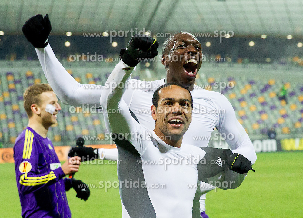 Marcos Tavares #9 of Maribor, Jean Philippe Mendy #14 of Maribor and other players of Maribor celebrate after winning during football match between NK Maribor and Wigan Athletic FC (ENG) in Round 6 of Group D of UEFA Europa League 2014, on December 12, 2013 in Stadion Ljudski vrt, Maribor, Slovenia. Maribor won against Wigan 2-1 and qualified to next Stage. Photo by Vid Ponikvar / Sportida