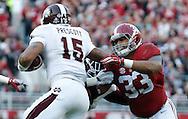 Nov 15, 2014; Tuscaloosa, AL, USA; Alabama Crimson Tide linebacker Trey DePriest (33) grabs Mississippi State Bulldogs quarterback Dak Prescott (15)<br /> at Bryant-Denny Stadium. Mandatory Credit: Marvin Gentry