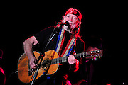 Legendary musician Willie Nelson plays The Pallidium in Dallas Texas as part of an ASPCA fundraiser for Super Bowl Weekend. The show was special Willie messed up the words to his own songs and could not keep up with the band.Photo©SuziAltman