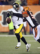 Pittsburgh Steelers quarterback Ben Roethlisberger (7) gets sacked for a loss of 12 yards to the Pittsburgh Steelers 5 yard line by Cincinnati Bengals outside linebacker Vontaze Burfict (55) at the end of the third quarter during the NFL AFC Wild Card playoff football game against the Cincinnati Bengals on Saturday, Jan. 9, 2016 in Cincinnati. The Steelers won the game 18-16. (©Paul Anthony Spinelli)