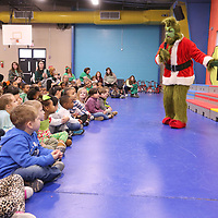 """The Grinch"" tells his story about he stole Christmas to the students at ECEC on Monday.."