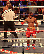 Picture by Richard Gould/Focus Images Ltd +44 7855 403186<br /> 13/07/2013<br /> Kell Brook (Red shorts) celebrates the win as and Carson Jones argues the ref pictured during their International Welterweight contest at Craven Park, Hull.