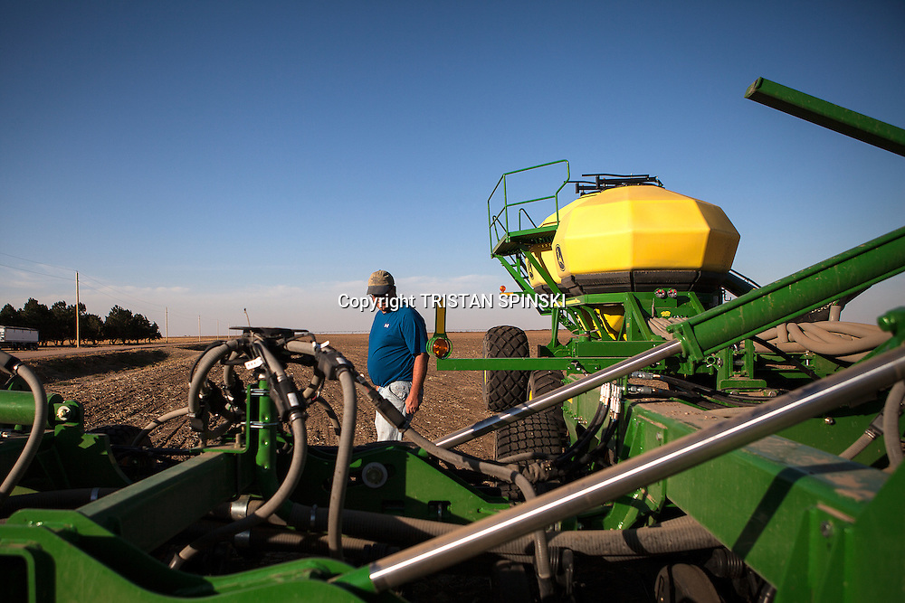 Mitchell Baalman inspects his farming equipment as he prepares to plant wheat on his family's 12,000-acre farm outside of Hoxie, Kan., on Thursday, Oct. 11, 2012. As historically dry conditions continue, farmers from South Dakota to the Texas panhandle rely on the Ogallala Aquifer, the largest underground aquifer in the United States, to irrigate crops. After decades of use, the falling water level ? accelerated by historic drought conditions over the last two years ? is putting pressure on farmers to ease usage or risk becoming the last generation to grow crops on the land. Farmers like Mitchell Baalman and Brett Oelke (not pictured), are part of a farming community in in Sheridan County, Kansas, an agricultural hub in western Kansas, who have agreed to cut back on water use for crop irrigation so that their children and future generations can continue to farm and sustain themselves on the High Plains.