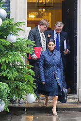 Downing Street, London, December 8th 2015. Employment Minister Priti Patel, Justice Secretary Michael Gove (R) and Culture secretary John Whittingdale leave Downing Street following the weekly cabinet meeting.