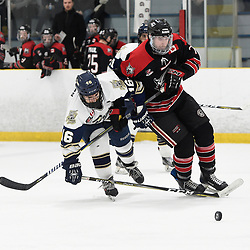 TORONTO, ON  - APR 10,  2018: Ontario Junior Hockey League, South West Conference Championship Series. Game seven of the best of seven series between Georgetown Raiders and the Toronto Patriots. Greame MacLean #16 of the Toronto Patriots tries to keep the puck from Andrew Cordssen-David #7 of the Georgetown Raiders during the second period.<br /> (Photo by Andy Corneau / OJHL Images)