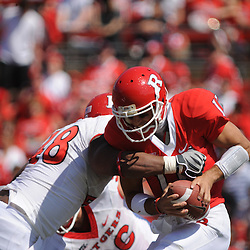 Apr 18, 2009; Piscataway, NJ, USA; Rutgers QB Domenic Natale (11) is wrapped up by DT Blaire Bines (48) during the first half of Rutgers' Scarlet and White spring football scrimmage.