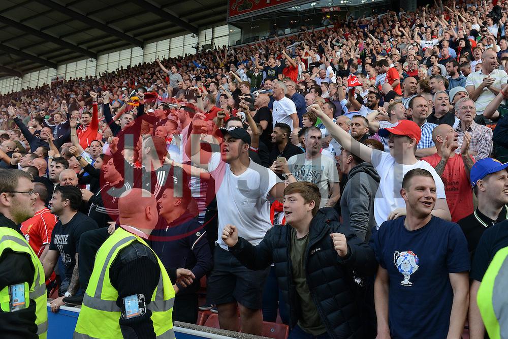 Liverpool fans celebrate as Philippe Coutinho scores the winning goal - Mandatory byline: Dougie Allward/JMP - 07966386802 - 09/08/2015 - FOOTBALL - Britannia Stadium -Stoke-On-Trent,England - Stoke City v Liverpool - Barclays Premier League
