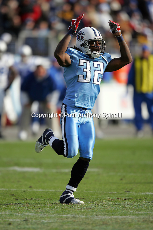 NASHVILLE, TN - DECEMBER 3:  Pacman Jones #32 of the Tennessee Titans waves his arms in celebration after returning a punt for a good gain against the Indianapolis Colts at LP Field on December 3, 2006 in Nashville, Tennessee. The Titans defeated the Colts 20-17. ©Paul Anthony Spinelli *** Local Caption *** Pacman Jones
