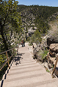 Tourists on the stairs leading to the Island Trail in Walnut Canyon National Monument