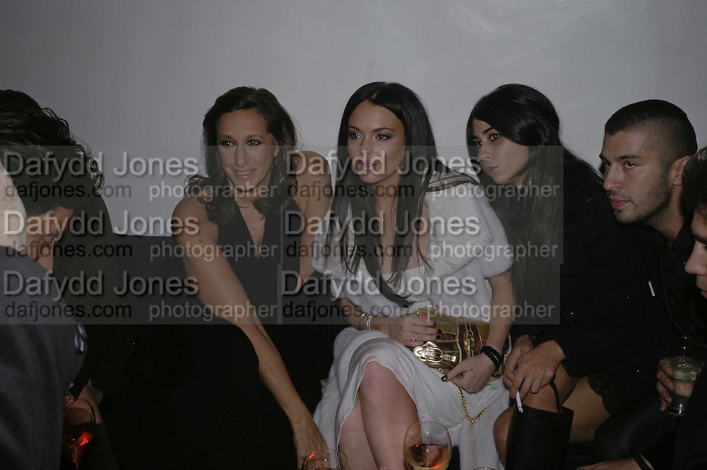 Donna Karan and  Lindsay Lohan, DONNA KARAN GOLD FRAGRANCE COLLECTION LAUNCH <br />IN BENEFIT OF ÔOVER THE WALL, Donna Karan shop. New Bond St. London. 16 November 2006. 'ONE TIME USE ONLY - DO NOT ARCHIVE  © Copyright Photograph by Dafydd Jones 66 Stockwell Park Rd. London SW9 0DA Tel 020 7733 0108 www.dafjones.com