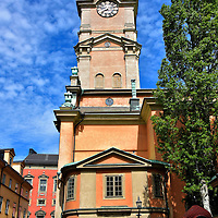 Storkyrkan Cathedral Clock Tower in Stockholm, Sweden<br /> Dominating the skyline of Gamla stan, the Old Town of Stockholm, is Storkyrkan. The clock tower reaches 216 feet. Located next to the Royal Palace, the cathedral is historically the site of royal religious ceremonies. Church of St. Nicholas was founded in 1279. The Great Church was completed in 1306 and reconstructed in 1740.