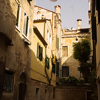 Italian street with houses and street light in Venice
