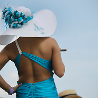 Nicole Finch, from New Orleans, smoked a cigar as she waited for the 9th race to run at the 138th running of the Kentucky Derby at Churchill Downs in Louisville, Ky. Saturday May 5, 2012.  Photo by David Stephenson