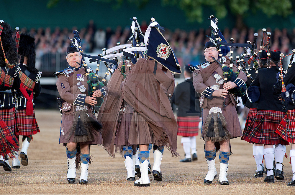 © London News Pictures. 10/06/2015. London, UK. Pipers of 1st Battalion Scots Guards perform a song on the march. Waterloo 200 themed open air Beating Retreat, performed on Horseguards Parade in London. Photo credit: Sergeant Rupert Frere/LNP