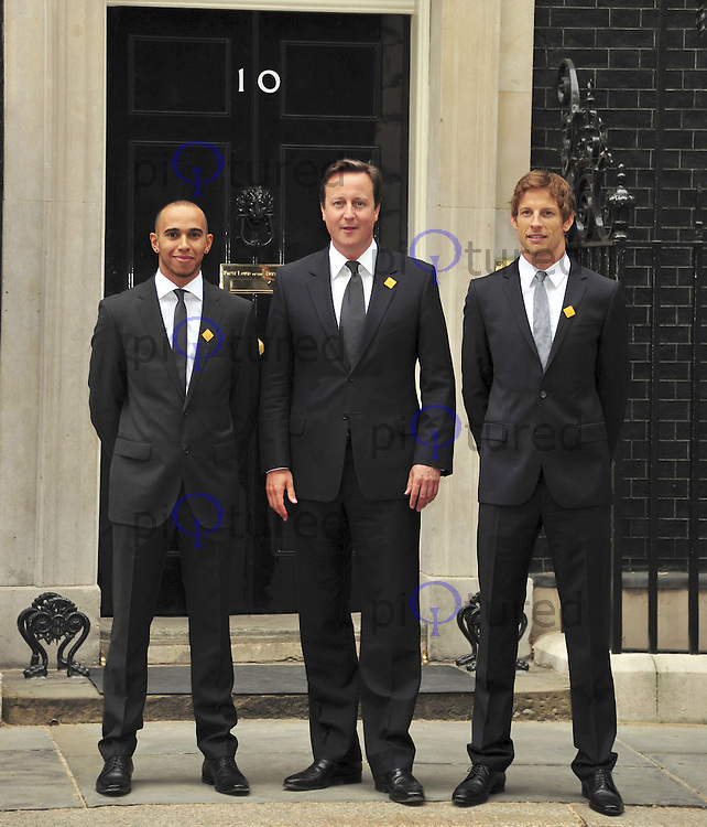 Lewis Hamilton and Jenson Button meet with Prime Minister David Cameron to launch UN Decade of Action for Road Safety at number 10 Downing Street London. UK, 11 May 2011:  Contact: Rich@Piqtured.com +44(0)7941 079620 (Picture by Alan Roxborough)
