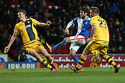 Danny Graham of Blackburn Rovers gets a shot off during the Sky Bet Championship match between Blackburn Rovers and Fulham at Ewood Park, Blackburn, England on 16 February 2016. Photo by Simon Brady.