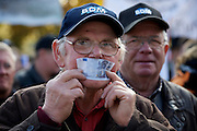 Mainz | Oct 30 2009..A Dairy farmer is seen closing his mouth with a 5 Euro bank note during a protest march of german dairy farmers rallying nationwide against low prices for milk and unfair subsidy policy of the EU (European Union).  ..Photo: juelich/ip-photo.com