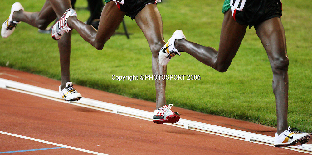 The legs of three Kenyan runners during the 5000m race on Day 5 of the XVIII Commonwealth Games at the MCG, Melbourne, Australia on Monday 20 March, 2006. Photo: Hannah Johnston/PHOTOSPORT<br />