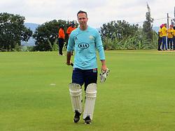 BEST QUALITY AVAILABLE Former England captain Michael Vaughan walks off after being caught and bowled out by Kenyan all-rounder Steve Tikolon during a celebrity T20 match following the official opening of a new cricket stadium in Kigali, Rwanda.