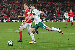 Switzerland's Stephan Lichtsteiner (left) and Northern Ireland's Stuart Dallas battle for the ball during the FIFA World Cup Qualifying second leg match at St Jakob Park, Basel.