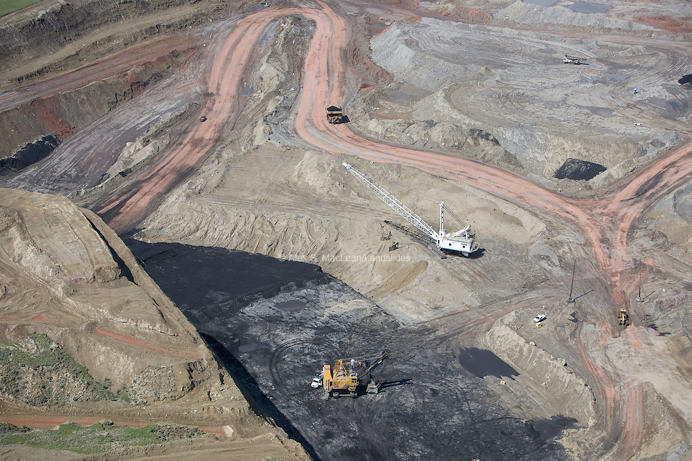 Coal strip mining in the Powder River Basin. Strip mining is a type of surface mining that involves excavating earth and rock to uncover a layered mineral reserve. The excavation of the overburden (overlying material) is completed in rectangular blocks in pits or strips. This coal is specifically desirbale fo its low sulfur and ash content. Coal supplies about half of the United States' electricity supplies, with the Powder River Basin mines supplying around 40 percent of those supplies.