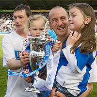 St Johnstone v Morton....02.05.09<br /> Stuart McCaffrey joins Paul Sheerin and his daughters Dervla and Orla with the first division trophy<br /> Picture by Graeme Hart.<br /> Copyright Perthshire Picture Agency<br /> Tel: 01738 623350  Mobile: 07990 594431