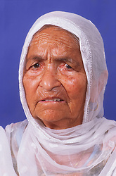 Portrait of elderly woman wearing head scarf,