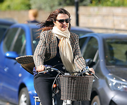 (EXCLUSIVE PICTURES) Actress Rachel Weisz wearing dark shades, scarf, check blazer, blue top, black jeans and trainers, was spotted riding her bike around London... 20/09/2019<br />