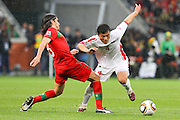CAPE TOWN, SOUTH AFRICA, MONDAY 21 June 2010, PAK Nam Choi gets challenged by Pedro Mendes during the match between Portugal and Korea PRK held at the new Cape Town Stadium in Green Point during the 2010 FIFA World Cup..Photo by Roger Sedres/Image SA
